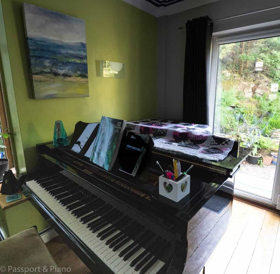 An image of a piano with everything close by for effective music practice